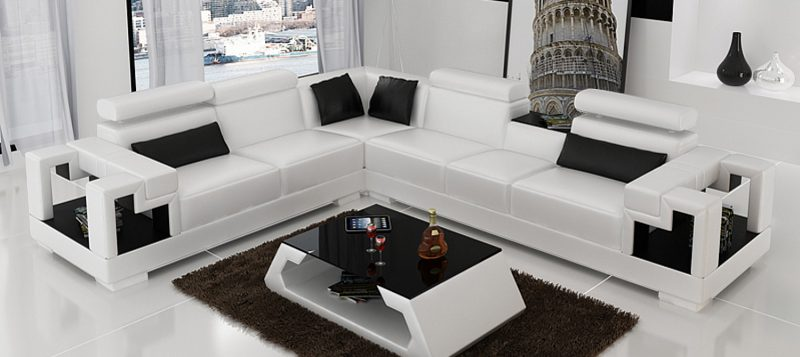 Fancy Homes Aliant-B corner leather sofa in white and black colour with storage armrests, adjustable headrests and in-built middle table. Matching coffee table is also available to create a cohesive home interior