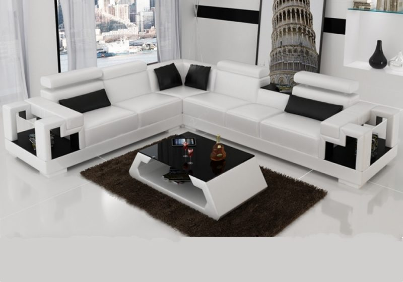 Fancy Homes Aliant-B corner leather sofa in white and black leather featuring in-built middle table, adjustable headrests and storage armrests. Matching coffee table is also available to create a cohesive look