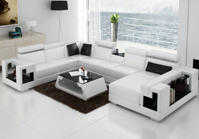 Fancy Homes Aliant modular leather sofa in white and black leather featuring in-built middle table, storage armrests and adjustable headrests