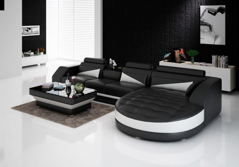 Fancy Homes Savino-C chaise leather sofa in black and white leather featuring round chaise, in-built coffee table and adjustable headrests