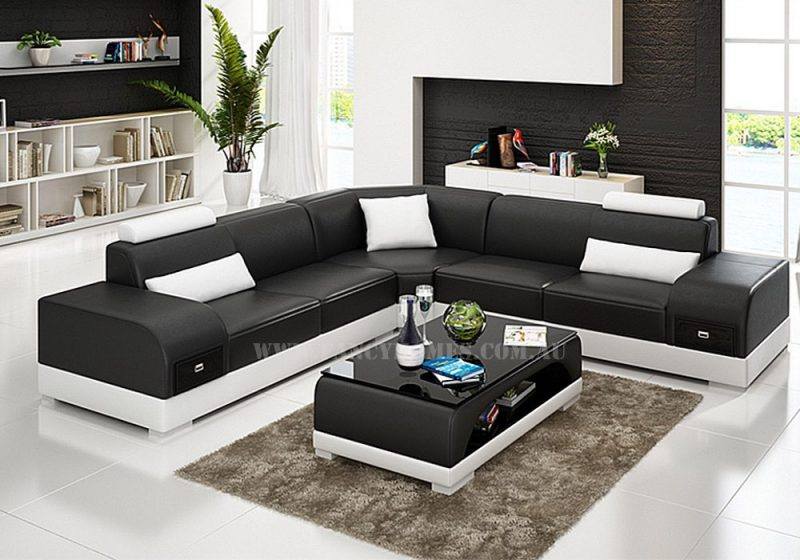 Fancy Homes Aura-C corner leather sofa in black and white leather features storage armrests and adjustable headrests