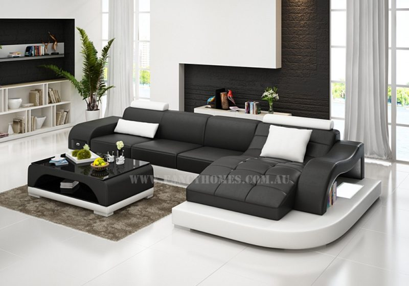 Fancy Homes Aura-D chaise leather sofa features curved chaise, storage armrest, LED lighting system and adjustable headrests