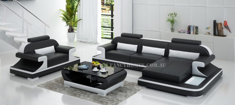 Fancy Homes Bruno-E chaise leather sofa in black and white leather comes with a single armchair. It features curved armrests, adjustable headrests and LED lighting systems.