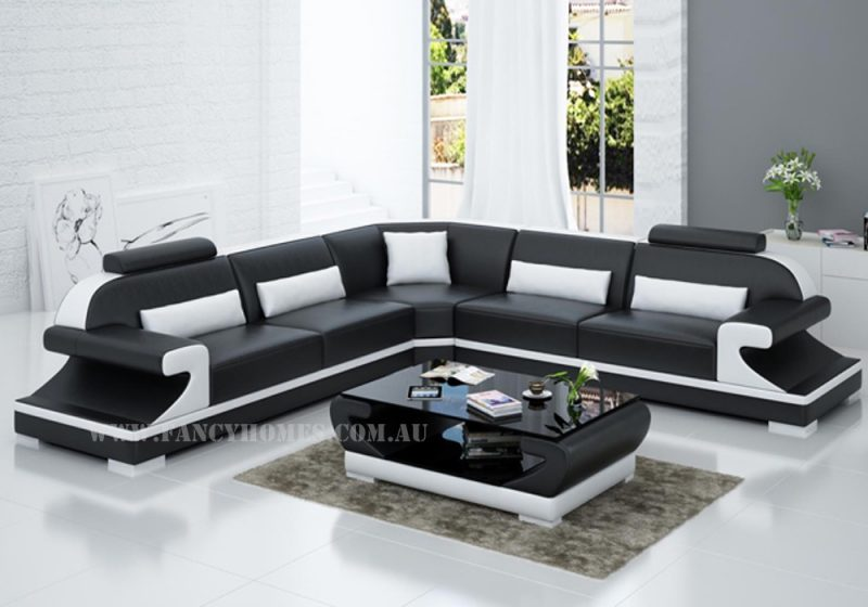 Fancy Homes Bruno-B corner leather sofa in black and white leather featuring curved armrests and adjustable headrests