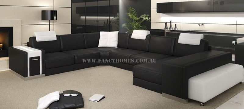 Fancy Homes Donata modular leather sofa in black and white leather comes with adjustable headrests, in-built LED lighting and drawer unit, wheel ottoman.