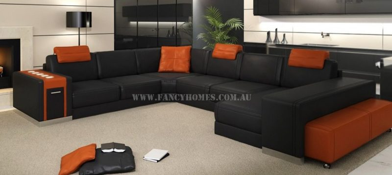 Fancy Homes Donata modular leather sofa in black and orange leather features adjustable headrests, removable ottoman, storage armrest and LED lighting system