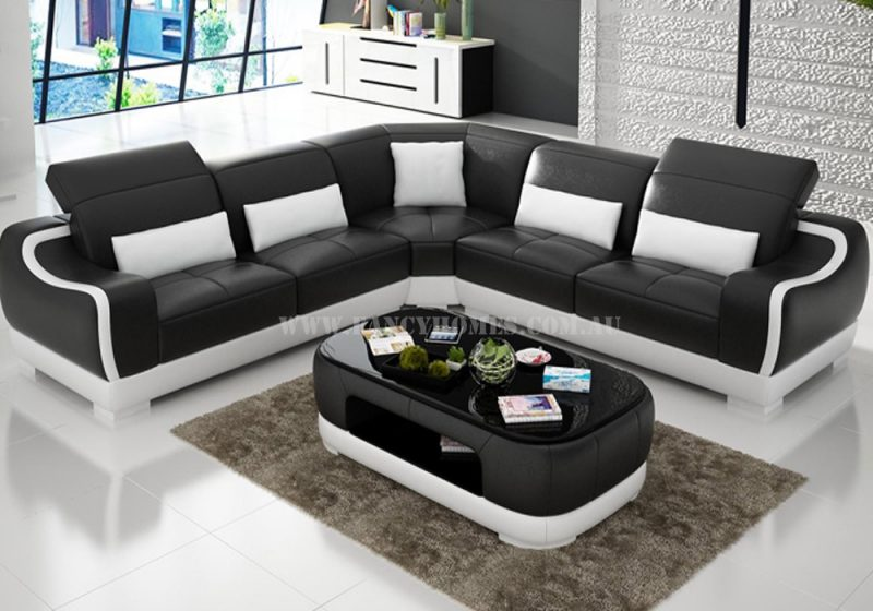 Fancy Homes Doreen-B corner leather sofa in black and white leather featured with uniquely designed armrests and adjustable headrests