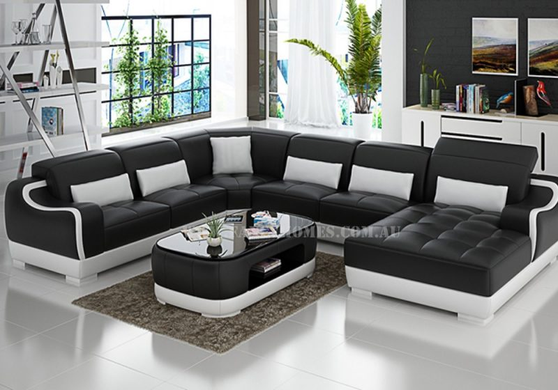 Fancy Homes Doreen modular leather sofa in black and white leather featured with adjustable headrests and uniquely designed armrests