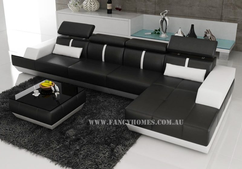 Fancy Homes Elite-B chaise leather sofa in black and white leather with built-in side table and adjustable headrests
