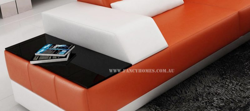 The in-built side table from Fancy Homes Elite-B chaise leather sofa comes with tempered glass