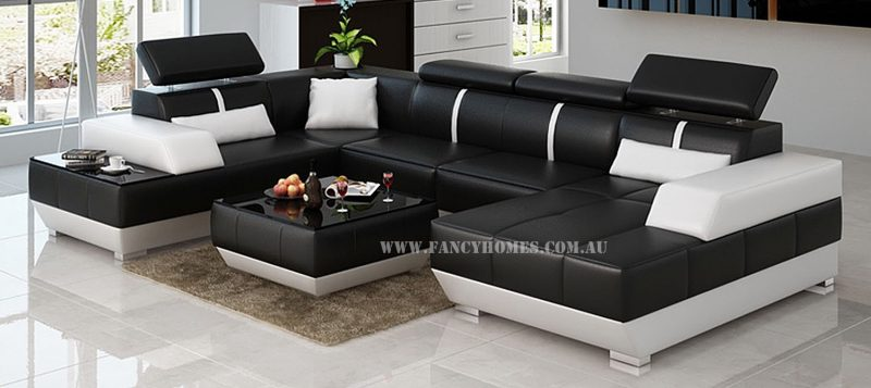 Fancy Homes Elite modular leather sofa in black and white leather featured with in-built side table and adjustable headrests