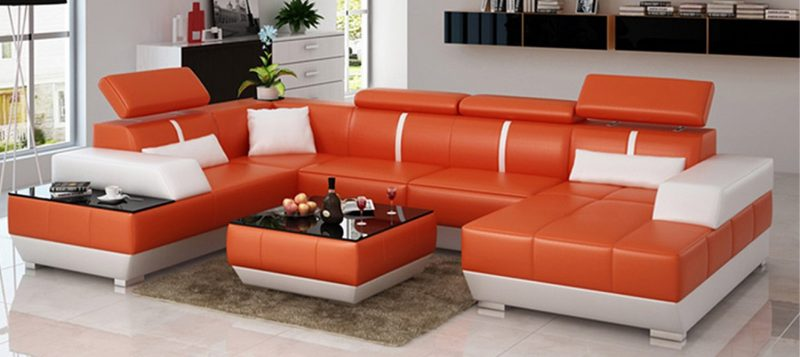 Fancy Homes Elite modular leather sofa in orange and white leather with built-in side table and easy-adjust headrests