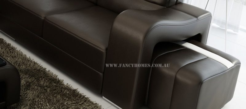 The curved armrest and removable ottoman of Fancy Homes Erika-B corner leather sofa.
