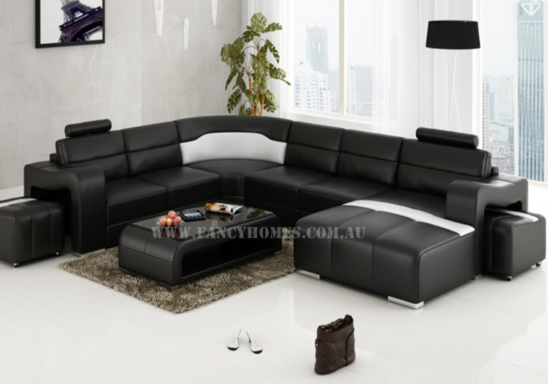 Fancy Homes Erika modular leather sofa in black and white leather featuring unique armrests and removable ottomans