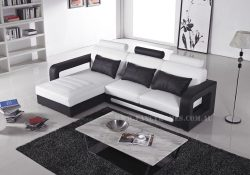 Fancy Homes Java-B chaise leather sofa in white and black leather featuring unique armrests design and easy-adjustable headrests