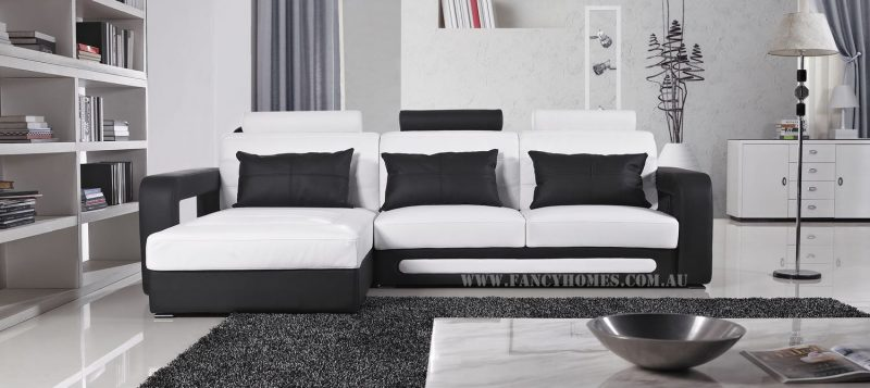 Fancy Homes Java-B chaise leather sofa in white and black leather featuring adjustable headrests