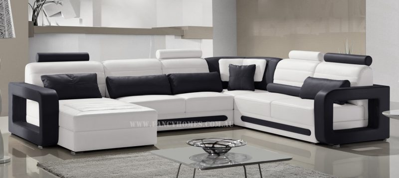 Fancy Homes Java modular leather sofa in white and black leather featuring adjustable headrests and unique armrests design