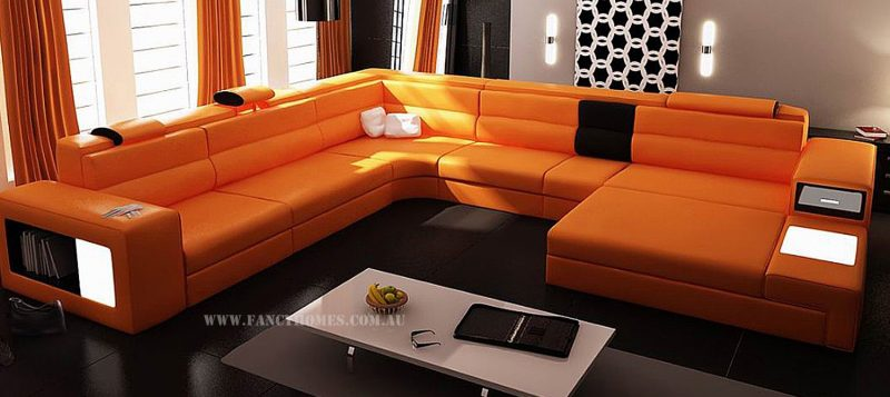 Fancy Homes Jolanda-B modular leather sofa in orange and black leather features adjustable headrests, lighting system, storage armrests and removable ottomans