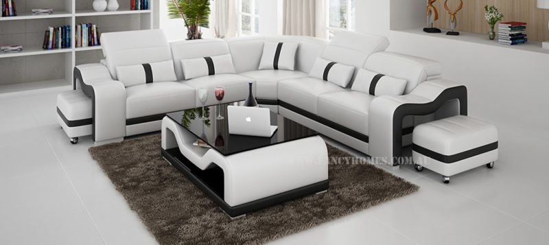 Fancy Homes Kori-B corner leather sofa in white and black leather featuring movable ottoman and adjustable headrests