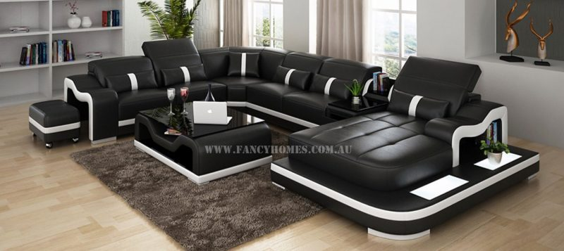 Fancy Homes Kori modular leather sofa in black and white leather featuring LED lighting system, middle table with drawer and movable ottoman