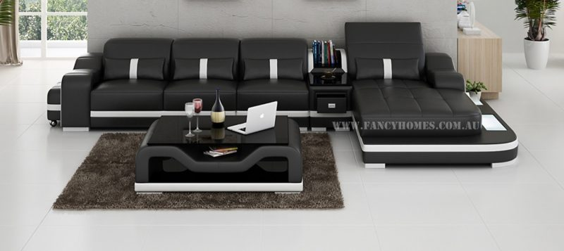Fancy Homes Kori-C chaise leather sofa in black and white leather with middle table, movable ottoman and LED lighting system