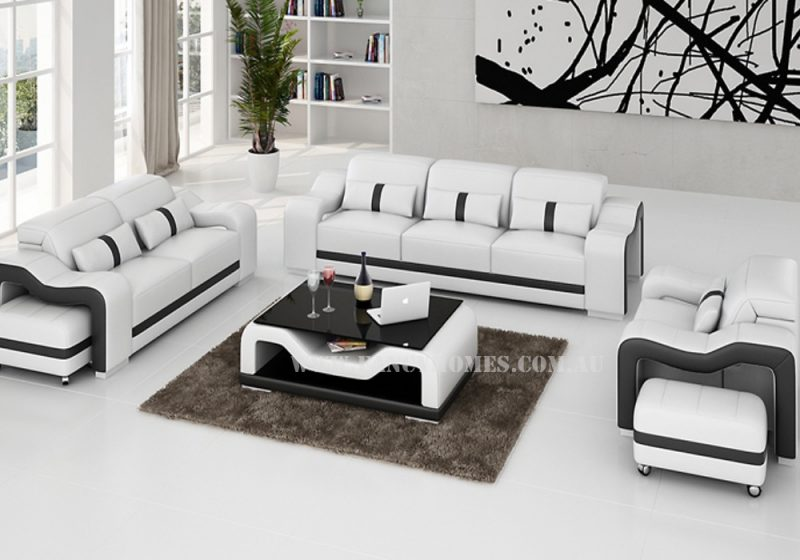Fancy Homes Kori-D lounge suites leather sofa in white and black leather with movable ottomans and adjustable headrests