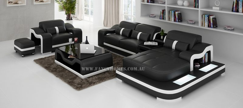Fancy Homes Kori-E chaise leather sofa in black and white leather with a single seater, movable ottoman, LED lighting system and adjustable headrests