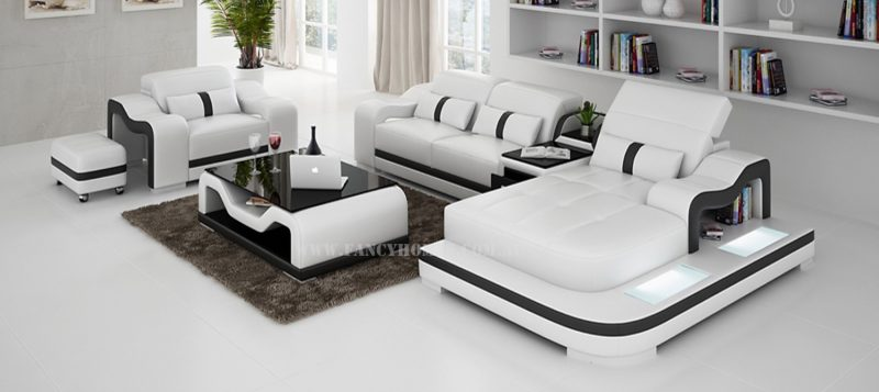 Fancy Homes Kori-E chaise leather sofa in white and black comes with a single seater. Featuring adjustable headrests, LED lighting system and storage middle table.