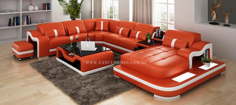 Fancy Homes Kori modular leather sofa in orange and white leather featuring LED lighting system, middle table with drawer and movable ottoman