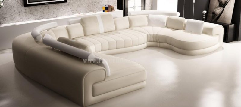 Fancy Homes Milo modular leather sofa in cream and white leather featuring unique curved shape
