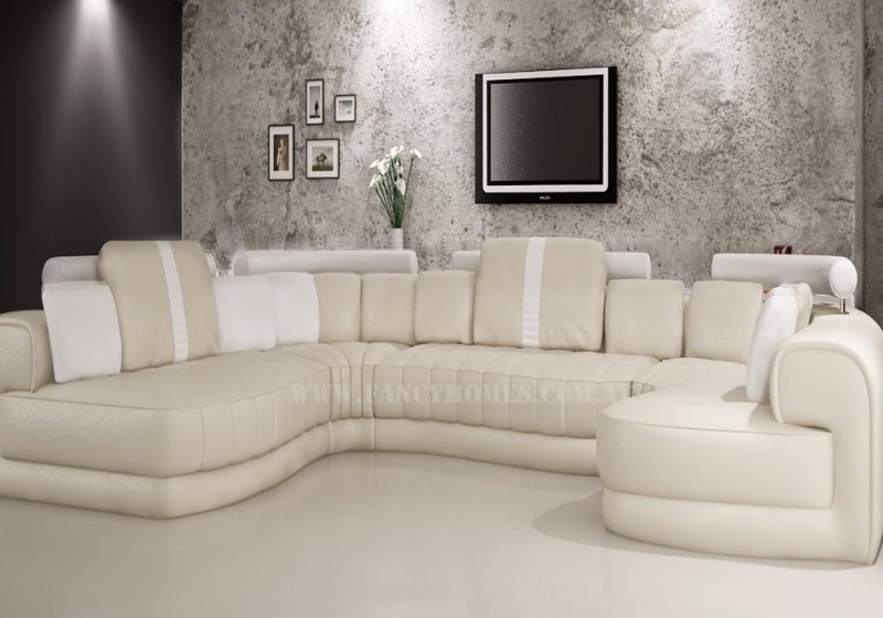 Fancy Homes Milo modular leather sofa in cream and white leather featuring curved design, adjustable headrests and extra-wide chaise