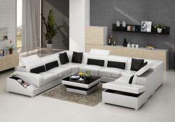 Fancy Homes Paloma corner leather sofa in white and black leather featuring easy-adjust headrests, book-shelf armrests and storage ottoman