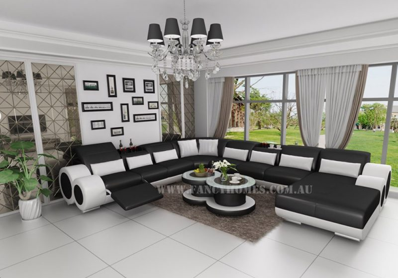 Fancy Homes Renata modular leather sofa in black and white leather with built-in middle table and foldable footrest