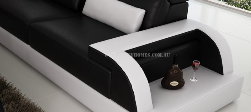 The curved design armrests of Siena-B corner leather sofa featuring open-shelf displays and storage functions