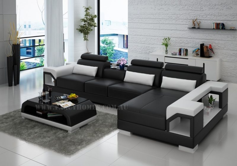Fancy Homes Vera-C chaise leather sofa in black and white leather featuring storage armrests, adjustable headrests and in-built cupholder