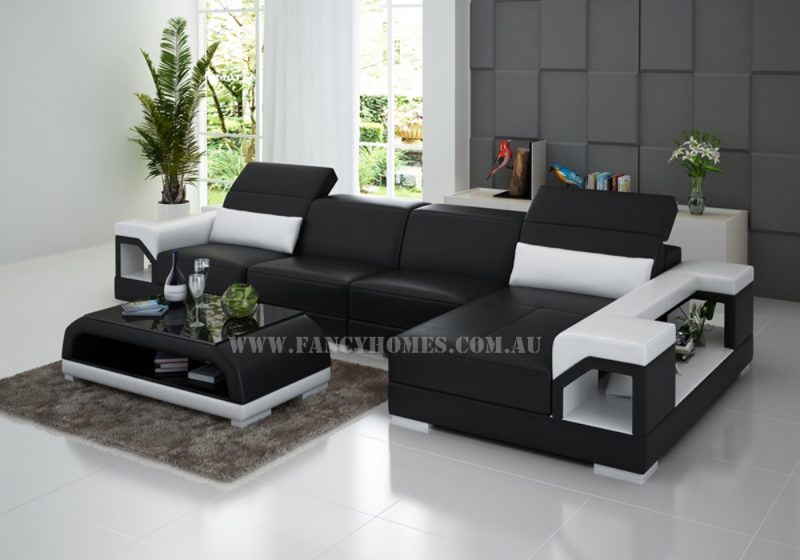 Fancy Homes Viva-C chaise leather sofa in black and white leather featuring easy-adjust headrests and storage arms