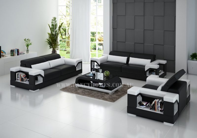 Fancy Homes Viva-D lounges suites leather sofa in black and white leather featuring adjustable headrests and storage armrests