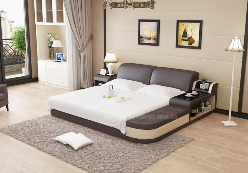 Fancy Homes Christi Leather Bed Frame Leather Bed in brown and beige featuring storage ottomans and bedhead, in-built side table