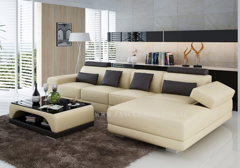 Casanova-C chaise leather sofa in beige and brown leather featuring storage armrest and adjustable headrests