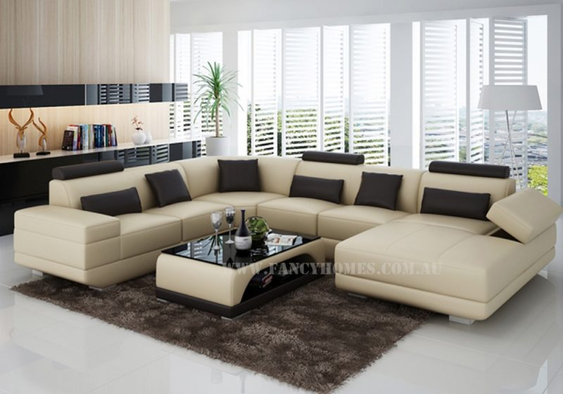Fancy Homes Casanova modular leather sofa in beige and black leather featuring extra wide chaise and storage armrests