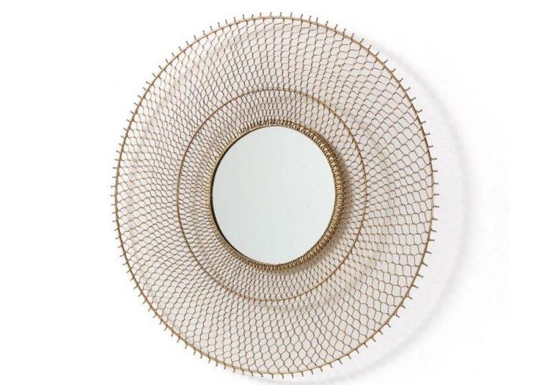 round mirror in metal grid