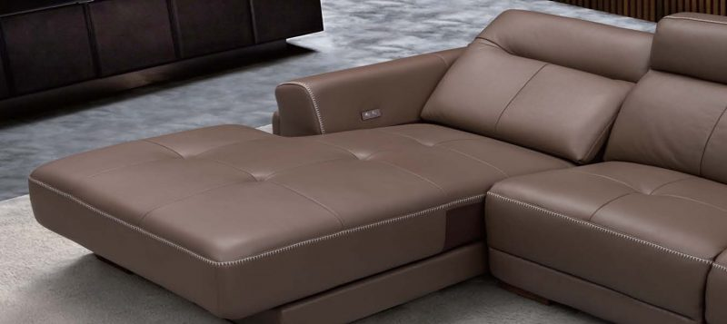 The chaise of Fancy Homes Winston recliner leather sofa can be transformed into a flat bed with one simple touch on the button