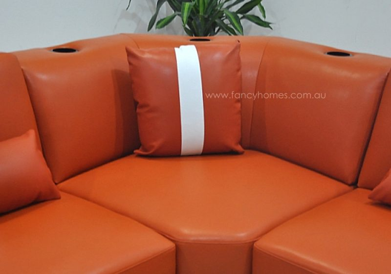 The corner of Fancy Homes Gianni modular leather sofa comes with cup holders