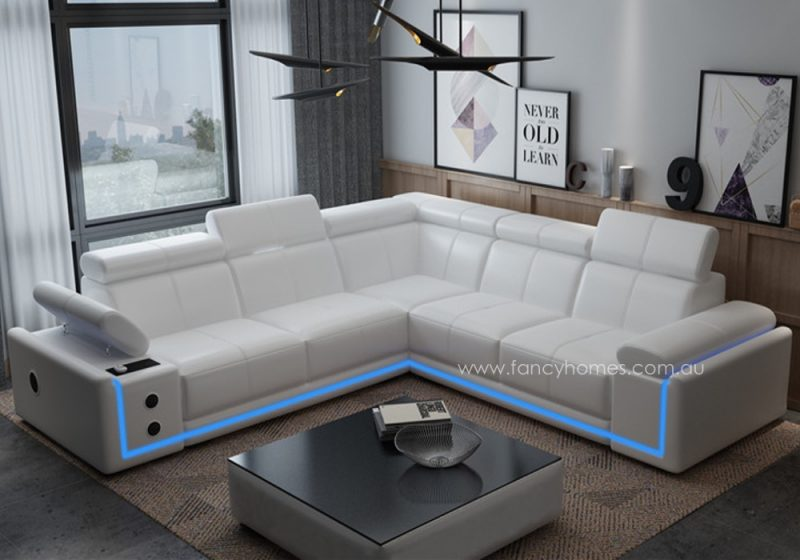 Fancy Homes Stereo-B corner leather sofa in white leather featuring adjustable headrests and armrest, LED lighting system, music players with speakers, wireless and USB chargers